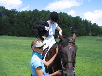 Betsy helping with Godiva while Janna gets ready on a hot day. Otter Creek Dressage Fest, 2010